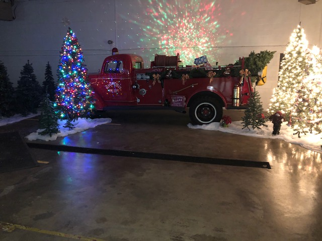 fire truck and christmas trees